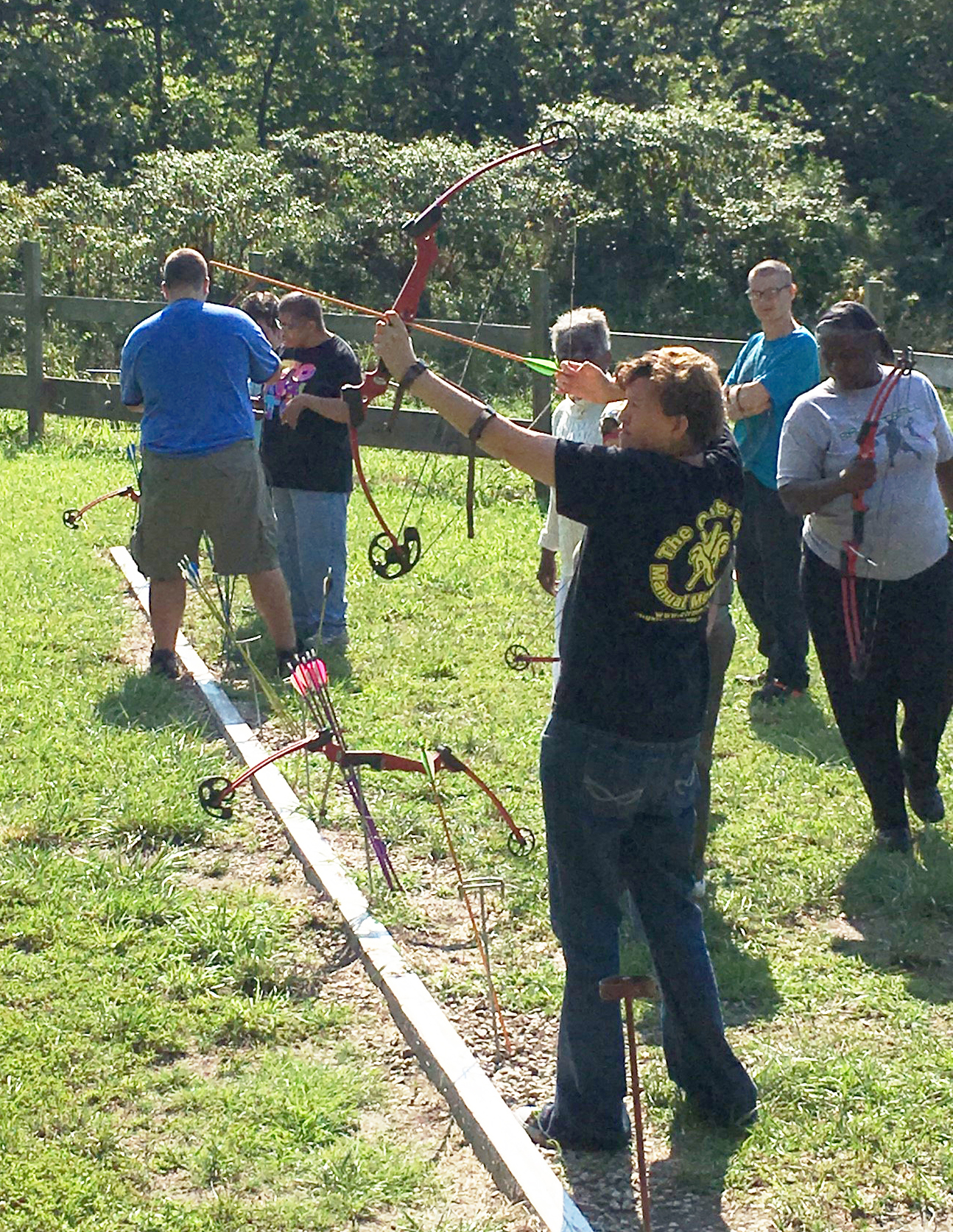 SLI campers doing archery.
